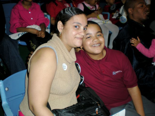 Nora Marcano and her son Joel, who attends Harlem Link Charter School at the Armory last night.