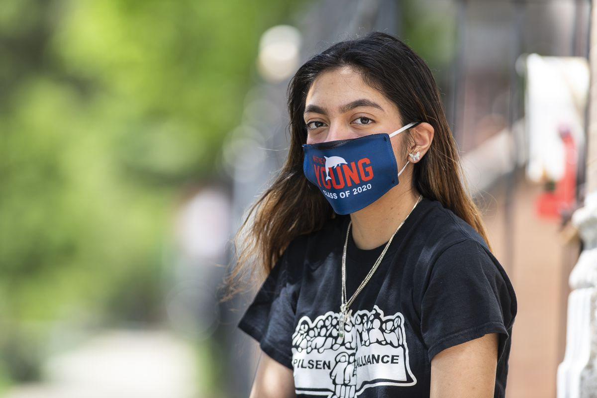Genesis Rivera, a senior at Whitney Young High School who tested positive for the coronavirus two weeks ago, sits in front of her home in Little Village, Thursday, May 28, 2020.