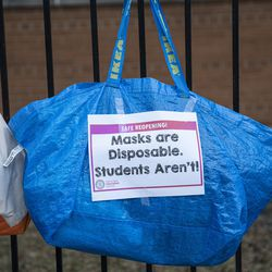 Signs are taped to the fencing outside of Suder elementary as teachers teach their virtual classes outside of the school in solidarity with pre-K educators forced back into the building at 2022 W Washington Blvd in West Town, Monday, Jan. 11, 2021.