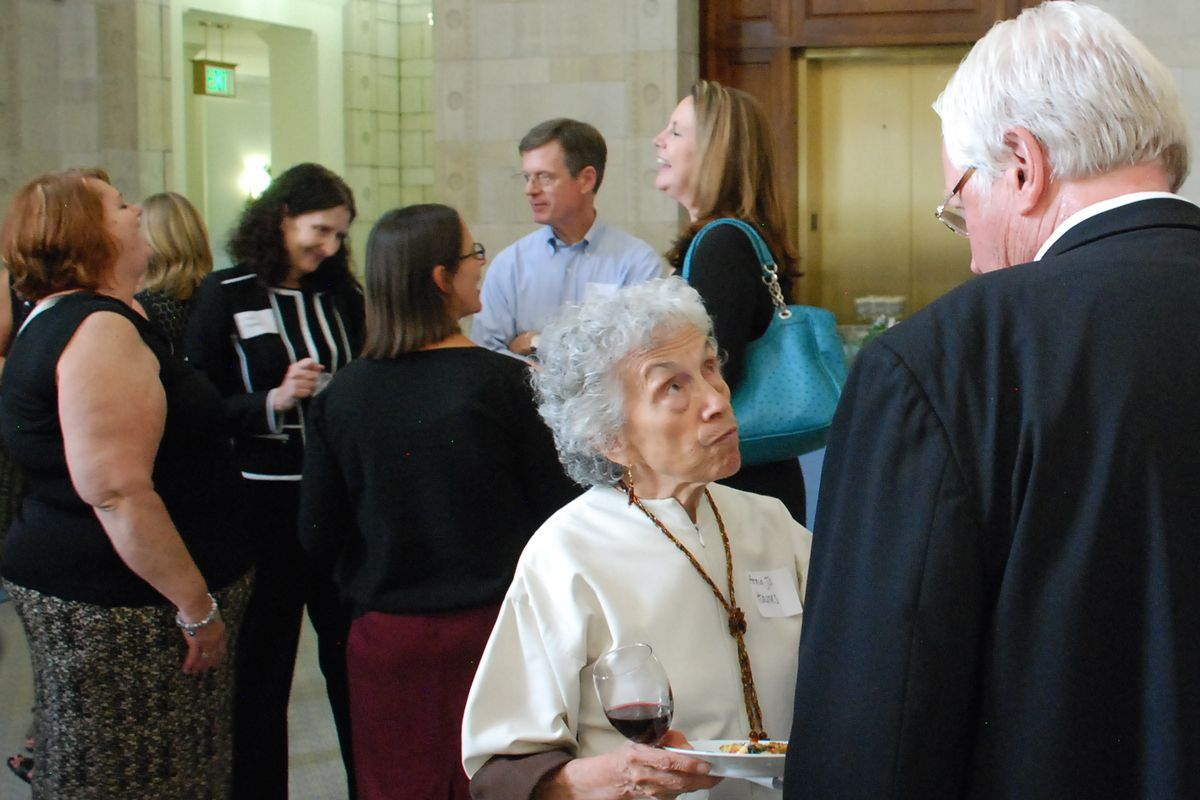 Anna Jo Haynes, co-chair of the Early Childhood Leadership Commission, chats with a guest at an event celebrating the release of the new Early Childhood Colorado Framework on Wednesday.