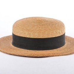 A Vintage Yves Saint Laurent tan and black straw hat. Buy it now for $200.