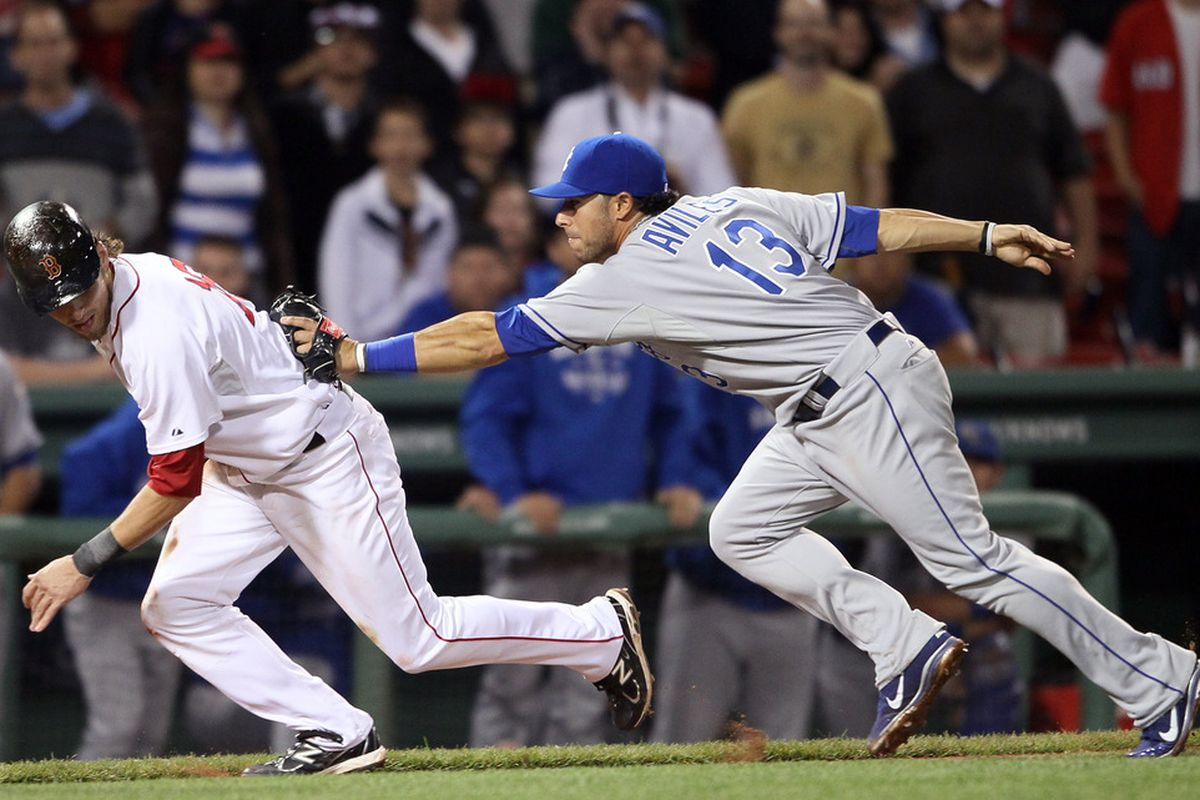 BOSTON, MA - JULY 26:  Josh Reddick #16 of the Boston Red Sox is caught stealing by Mike Aviles #13 of the Kansas City Royals in the 12th inning on July 26, 2011 at Fenway Park in Boston, Massachusetts.  (Photo by Elsa/Getty Images)