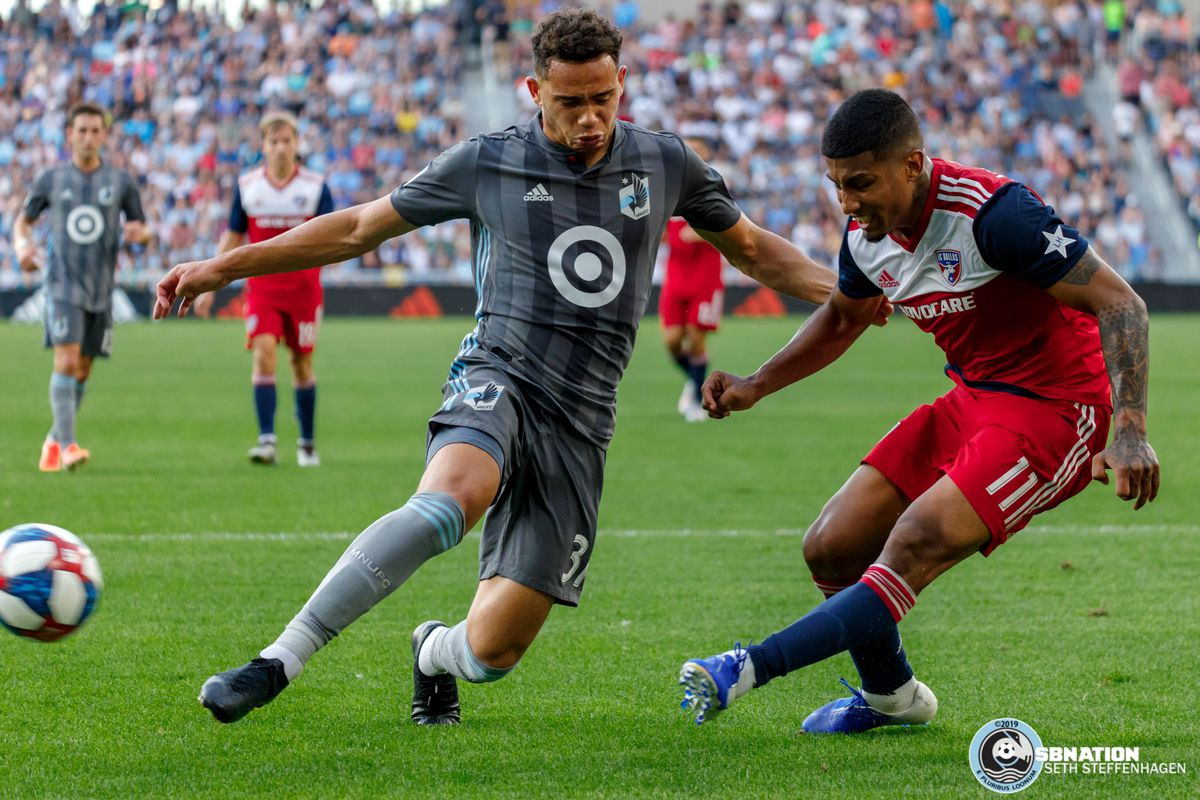 July 13, 2019 - Saint Paul, Minnesota, United States - Minnesota United  midfielder Hassani Dotson (31) lunges in to try and block a shot by FC Dallas midfielder Santiago Mosquera (11) during the match at Allianz Field.