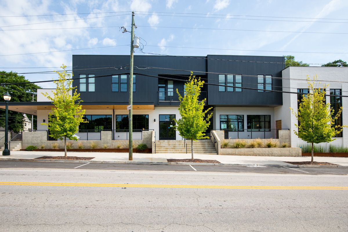 An exterior street shot of the gray and white modern building and future home of Perc Coffee at the Hosea and 2nd development in East Lake, Atlanta