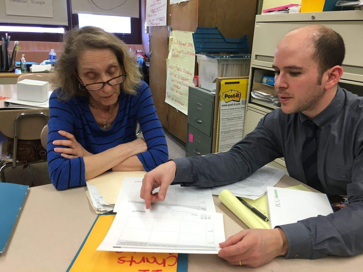 Peter Seidman discusses student work with Pat Sirulnick