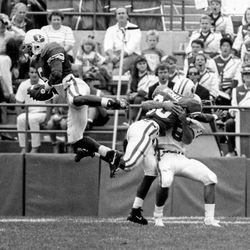 Former BYU defensive back Derwin Gray, far left, makes a leaping interception during the 1991 season.