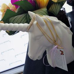Katy Perry and Rachel Bilson are fans of Jewelry by Veronique's whimsical wares. This unicorn pendant was a big hit.