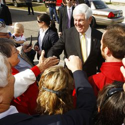 Republican presidential candidate and former House Speaker Newt Gingrich, center, campaigns outside Mama Lou's restaurant in Robertsdale, Ala., Saturday March 10, 2012.