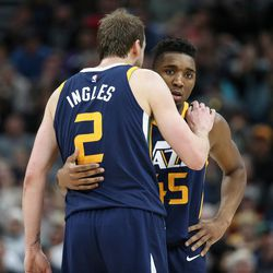 Utah Jazz forward Joe Ingles (2) and guard Donovan Mitchell (45) embrace on the court during the game against the Cleveland Cavaliers at Vivint Arena in Salt Lake City on Saturday, Dec. 30, 2017.
