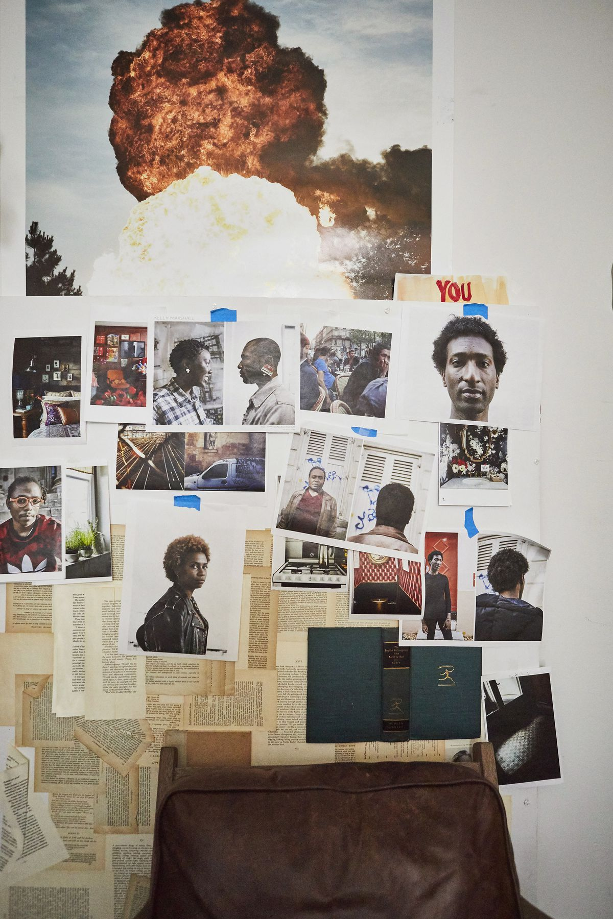 A wall shows a number of photographs of finished projects and works-in-progress.