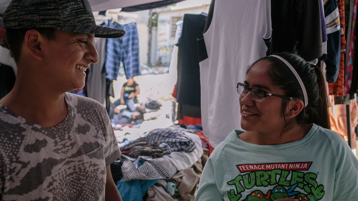 f8f3906ca7d5c Priscilla Hernandez and her boyfriend Eru Hernandez Campos at their used  clothing stall in Tijuana s Pípila market.