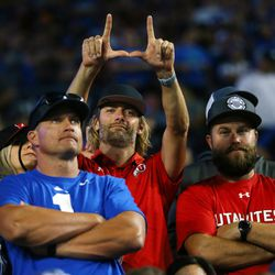 """A Utah fan holds up his """"U"""" as BYU and Utah play an NCAA football game at LaVell Edwards Stadium in Provo on Saturday, Sept. 11, 2021."""