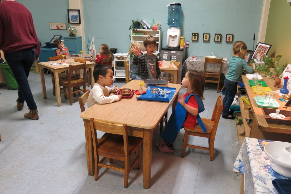 Students at Evergreen Montessori School work on a lesson together.