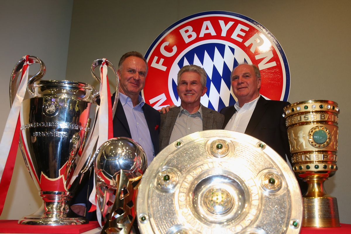 MUNICH, GERMANY - JUNE 04: Head coach Jupp Heynckes (C) of FC Bayern Muenchen poses alongside Club President Uli Hoeness (R), FC Bayern Muenchen CEO Karl-Heinz Rummenigge as they place the UEFA Champions League trophy, the German Super Cup winners trophy, German Bundesliga trophy and the German Pokal DFB Cup winners trophy in the club museum after a press conference at Allianz Arena on June 4, 2013 in Munich, Germany.