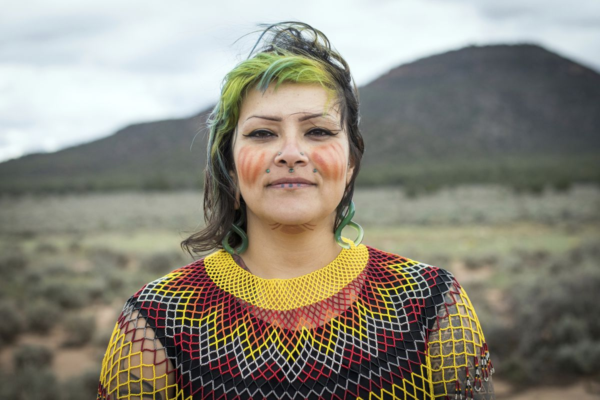 This undated photo provided by Amy Martin shows Ophelia Watahomigie-Corliss, a member of the Havasupai Tribal Council, at Red Butte, a site that the Havasupai consider sacred about 15 miles south of Tusayan, Ariz. Native American tribes are pushing the fe