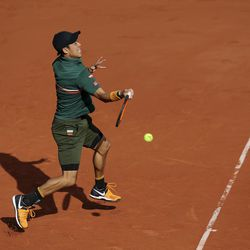 Japan's Kei Nishikori plays a shot against Britain's Andy Murray during their quarterfinal match of the French Open tennis tournament at the Roland Garros stadium, in Paris, France. Wednesday, June 7, 2017.