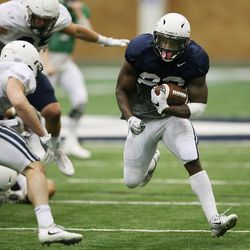 Brigham Young Cougars running back Squally Canada (22) runs during an intersquad scrimmage in Provo on Friday, March 23, 2018.