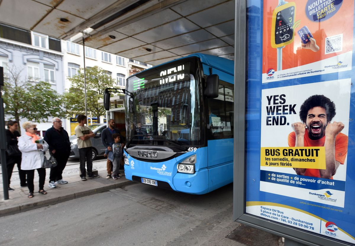 A poster at a bus stop in France advertises a free bus service on weekends and national holidays in the city of Dunkirk in 2017.