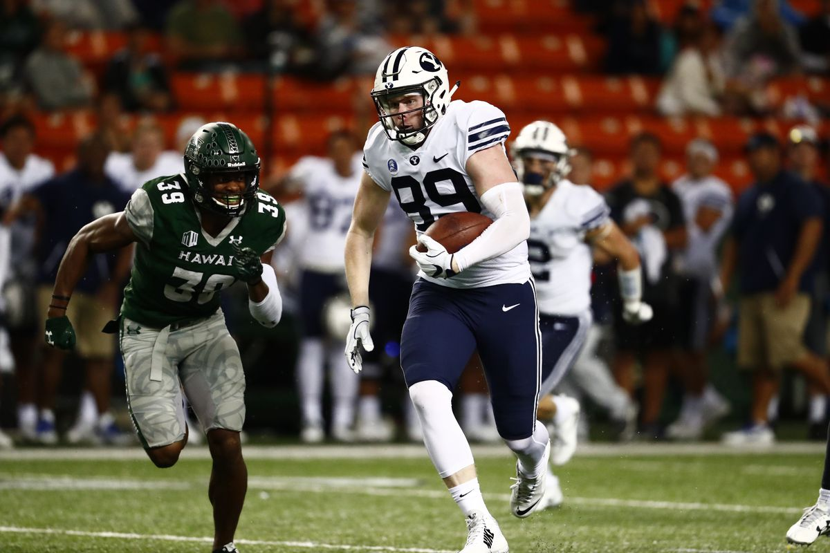 BYU tight end Matt Bushman runs after making a catch during the Cougars' game against Hawaii at Aloha Stadium in Honolulu on Saturday, Nov. 25, 2017.