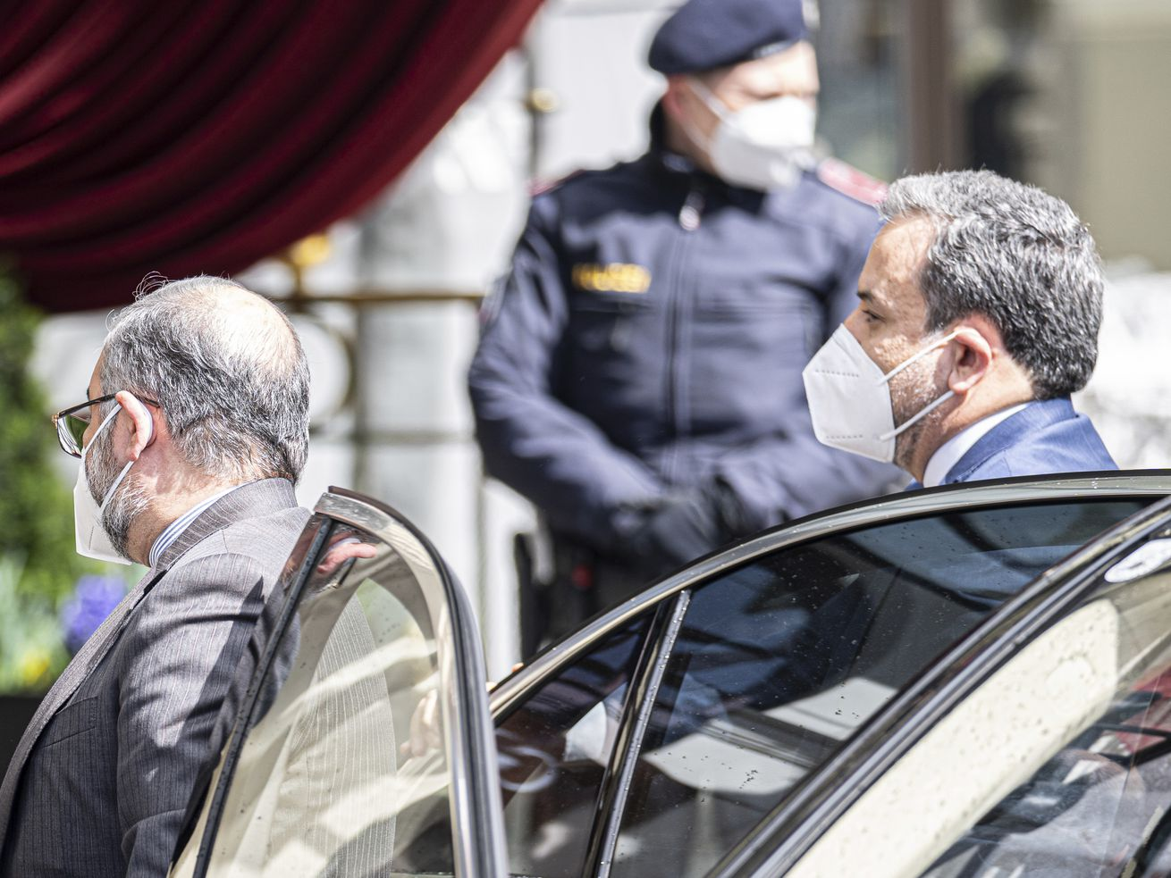 Political deputy at the Ministry of Foreign Affairs of Iran, Abbas Araghchi, right, arrives at the Grand Hotel Wien where closed-door nuclear talks with Iran take place in Vienna, Austria, Tuesday, April 6, 2021.