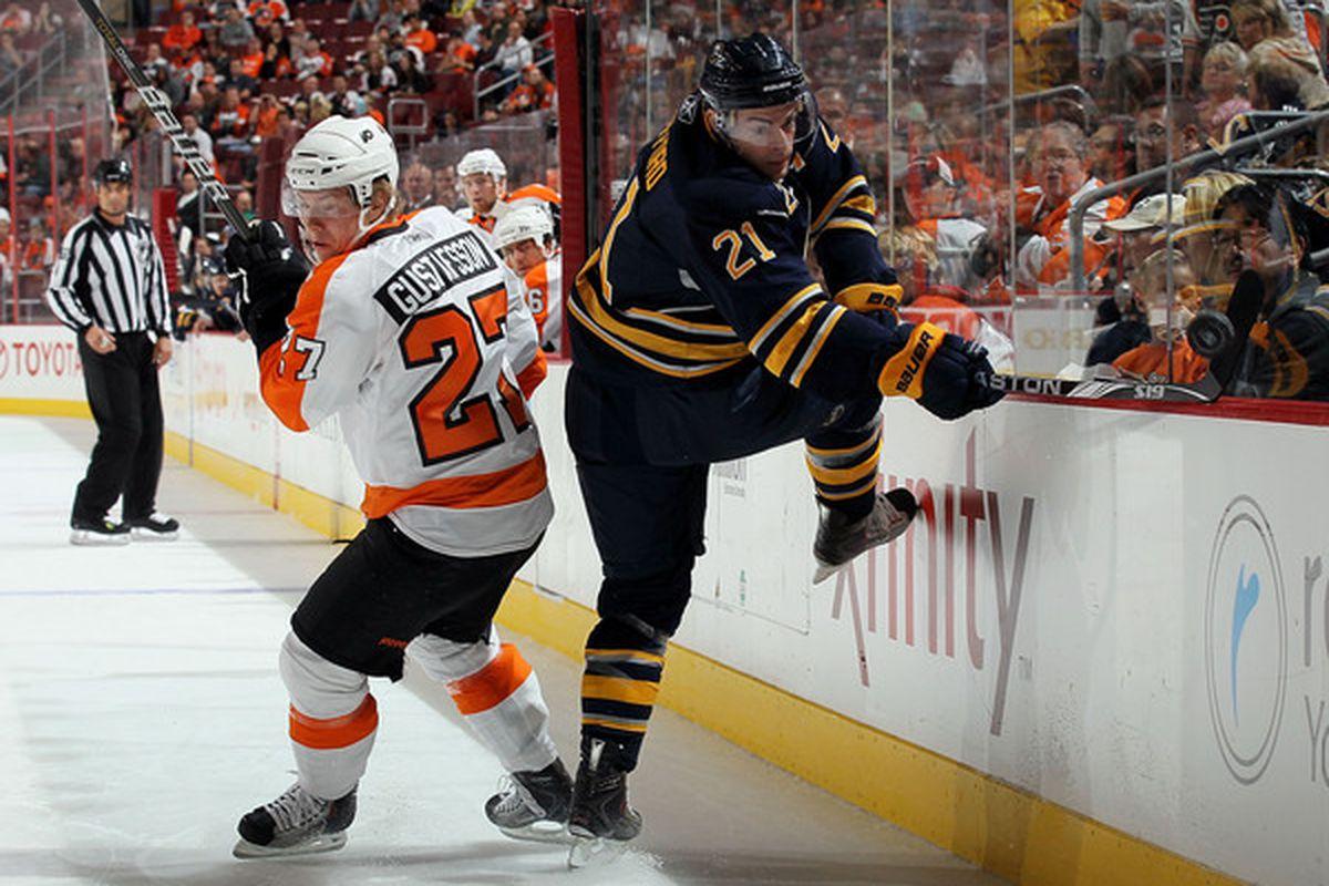 PHILADELPHIA - OCTOBER 01:  Drew Stafford #21 of the Buffalo Sabres skates against Erik Gustafsson #27 of the Philadelphia Flyers on October 1 2010 at Wells Fargo Center in Philadelphia Pennsylvania.  (Photo by Jim McIsaac/Getty Images)