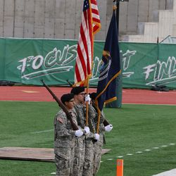 The ROTC Color Guard marching on the field prior to the game.