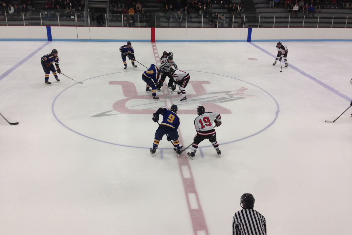 Reading and Arlington Catholic lineup for puck drop in Monday's second game at Burbank Ice Arena