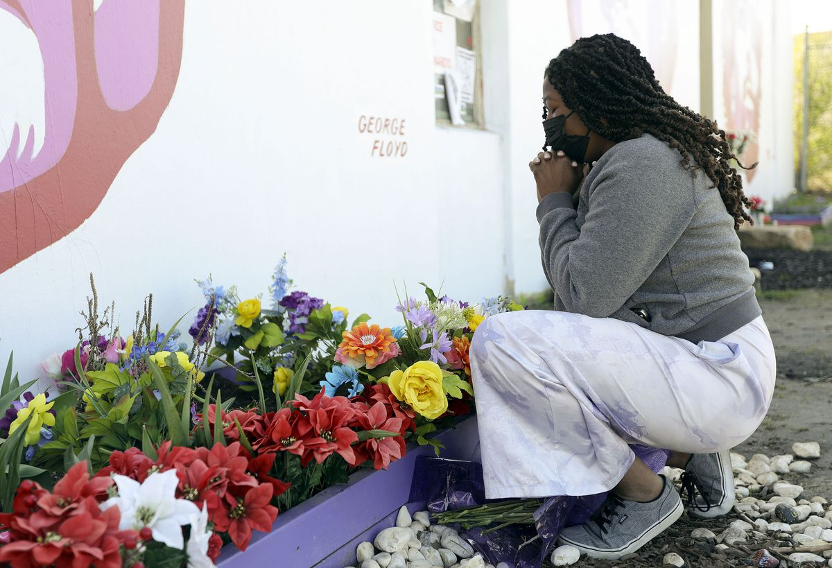 Ashley Cleveland visits the George Floyd mural on the corner of 800 South and 300 West in Salt Lake City on on Tuesday, April 20, 2021. A jury on Tuesday found former Minneapolis police officer Derek Chauvin guilty in Floyd's death.