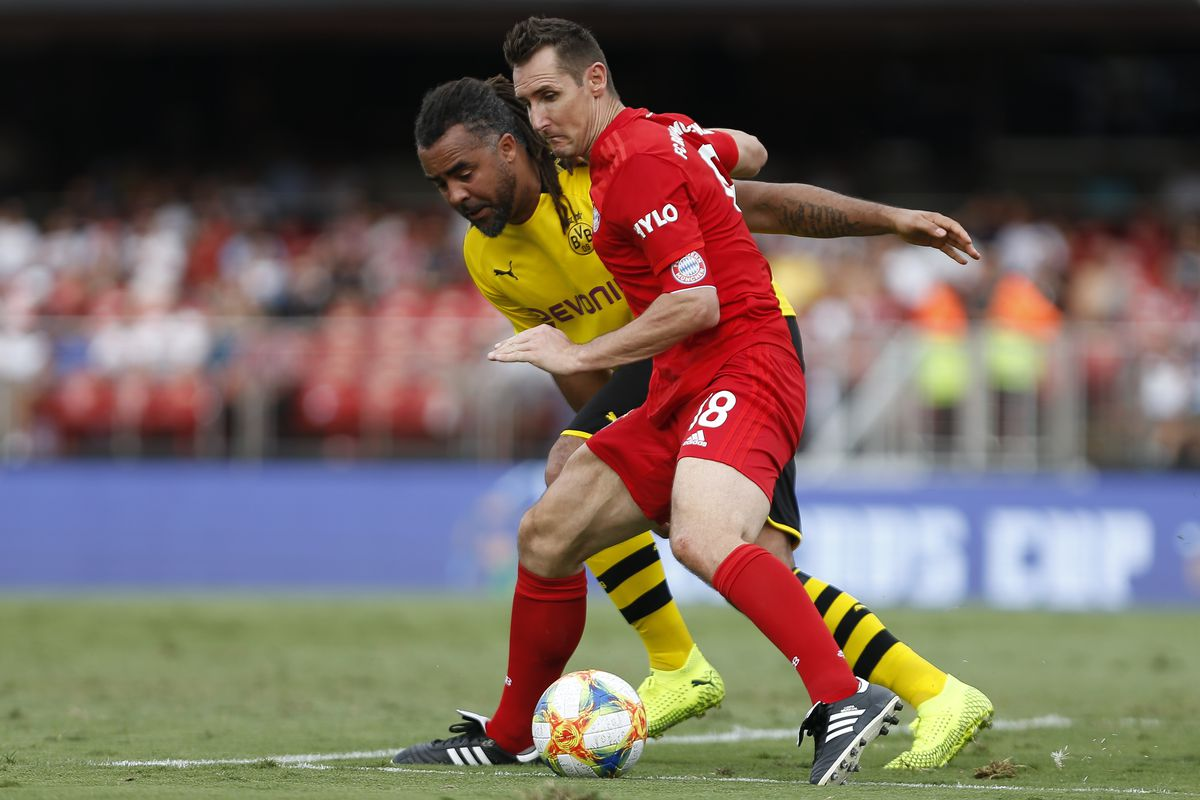 Miroslav Klose of FC Bayern Muenchen vies for the ball with Patrick Owomoyela of Borussia Dortmund during the football match for the third place between FC Bayern Muenchen and Borussia Dortmund for the Legends Cup 2019 in Sao Paulo, Brazil.