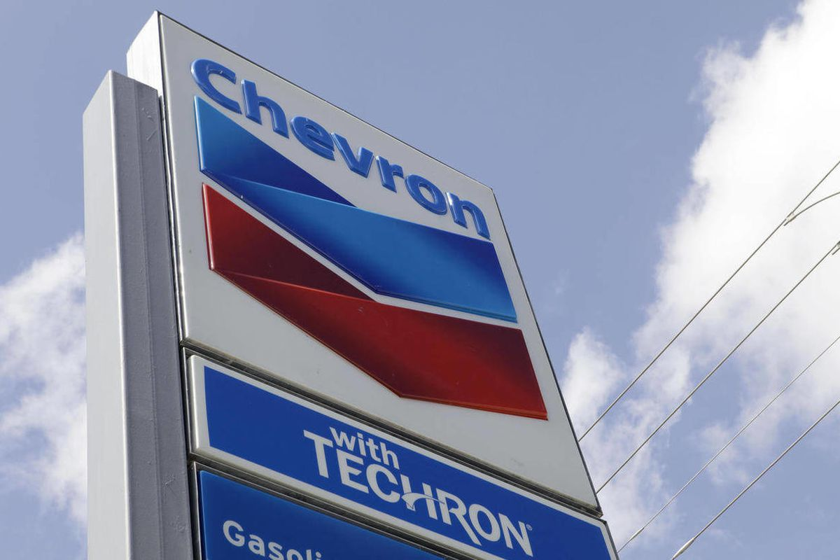 FILE - This July 25, 2011, file photo, shows a Chevron sign at a gas station in Miami. Chevron said Friday, April 27, 2012, profits rose 4.2 percent in the first quarter as it sold oil for higher prices. It reported earnings of $6.47 billion, or $3.27 per