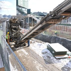 Concrete being delivered onto the conveyor belt truck
