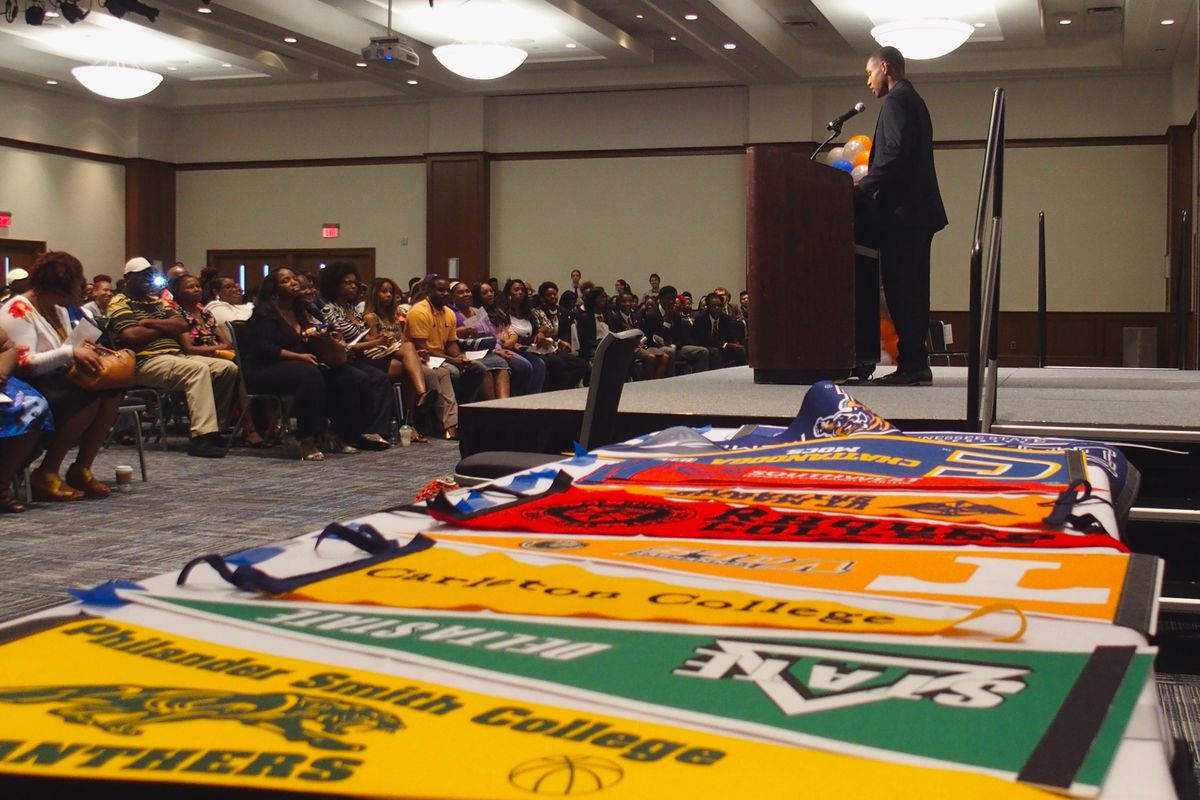A graduating senior speaks during an Academic Signing Day ceremony for Freedom Preparatory Academy, a Memphis charter school whose entire first graduating class is headed to college. Banners were on display to represent the schools they'll attend.