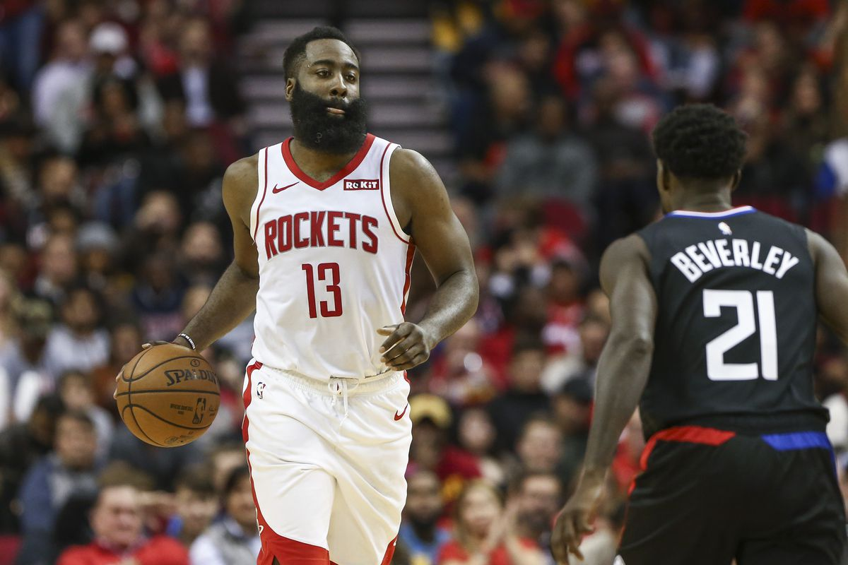 Houston Rockets guard James Harden dribbles the ball against Los Angeles Clippers guard Patrick Beverley during the fourth quarter at Toyota Center.