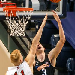 Brigham Young Cougars forward Matt Haarms (3) shoots the ball against Saint Mary's forward Matthias Tass (11) during a game against Saint Mary's Gaels in Provo on Saturday, Feb.27, 2021.