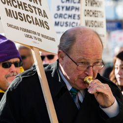 Tubaist Gene Porkorney marches with members of the Chicago Symphony Orchestra, who are on strike, in front of Symphony Center, Tuesday, March 12, 2019.   James Foster/For the Sun-Times