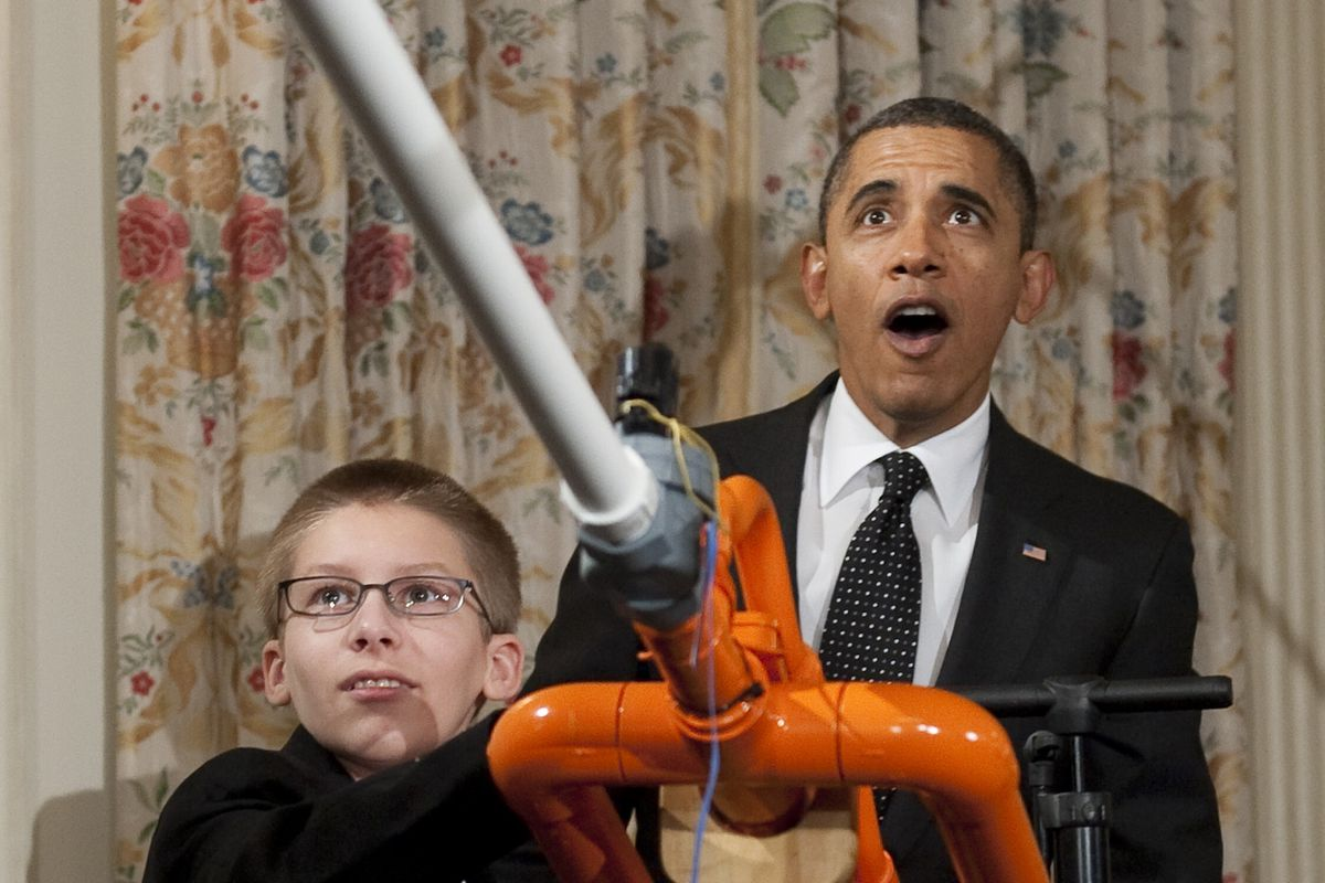 """Among the artifacts to be in the Obama Museum: The """"extreme marshmallow cannon,"""" from the 2012 White House Science Fair. President Obama is pictured with cannon creator Joey Hudy."""