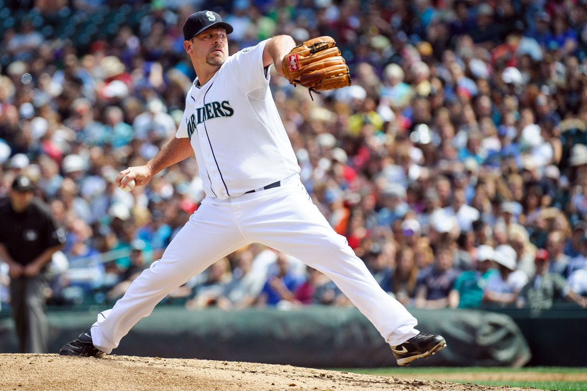 Jul 28, 2012; Seattle, WA, USA; Seattle Mariners starting pitcher Kevin Millwood (25) pitches to the Kansas City Royals during the 3rd inning at Safeco Field. Mandatory Credit: Steven Bisig-US PRESSWIRE
