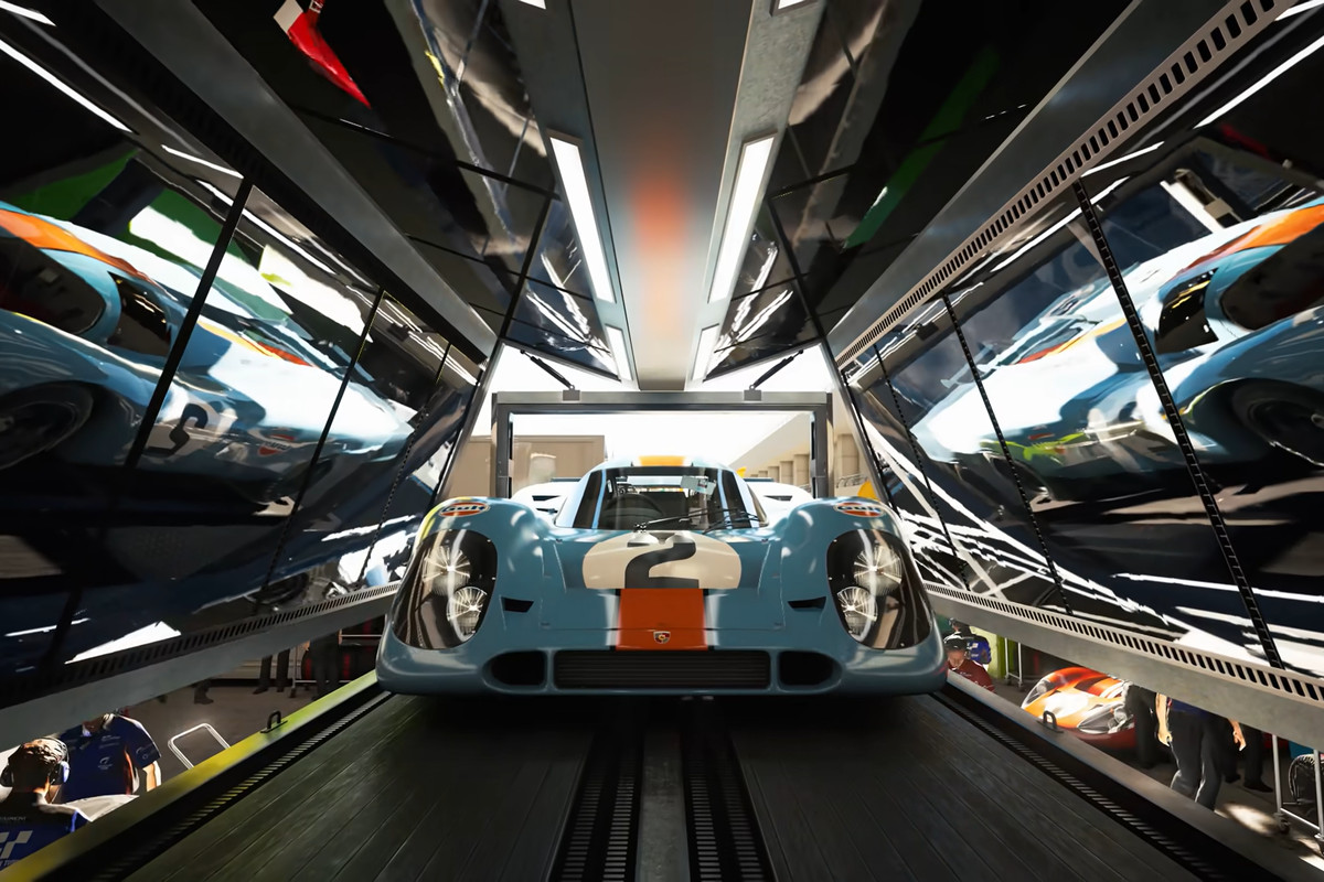 A blue racecar surrounded by shiny walls that are opening