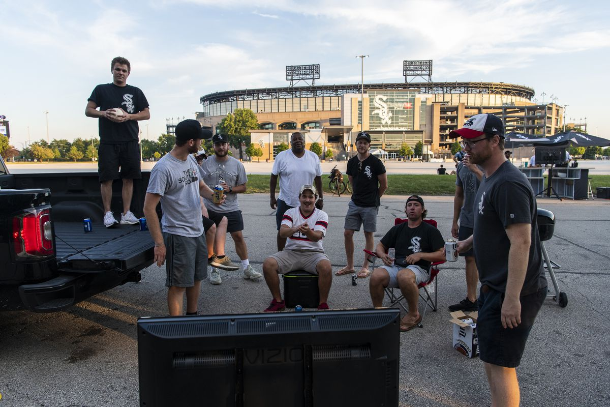 Fans of the Chicago White Sox tailgate outside of Guaranteed Rate Field during the opening day game against the Minnesota Twins, Friday evening, July 24, 2020.