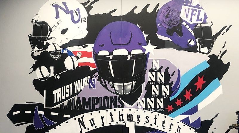 A mural inside the Northwestern players' lounge in Evanston, painted by Dwight White II in 2019.