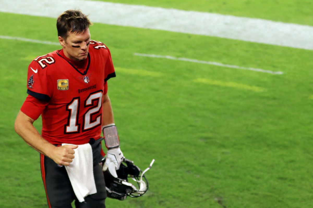 Tom Brady #12 of the Tampa Bay Buccaneers jogs off the field after being defeated by the New Orleans Saints 38-3 at Raymond James Stadium on November 08, 2020 in Tampa, Florida.