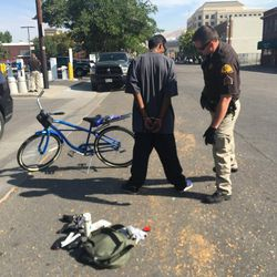 FILE - Law enforcement places man in handcuffs. A massive police effort is underway in Salt Lake's embattled Rio Grande neighborhood, the center of the state's homeless population and drug trade.