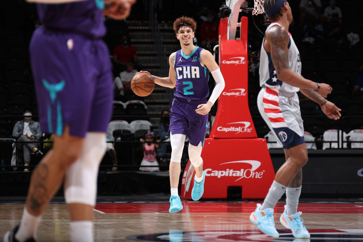 LaMelo Ball of the Charlotte Hornets smiles during the game against the Washington Wizards on May 16, 2021 at Capital One Arena in Washington, DC.