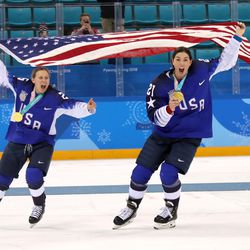 Gold medal winners Kendall Coyne #26 and Hilary Knight #21 of the United States celebrate.