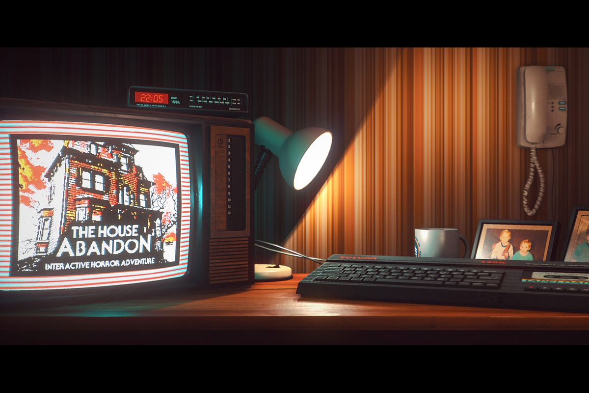 Stories Untold - a desk, with a light, a keyboard, and family photos on it, supports a computer screen showing a game called The House Abandon.