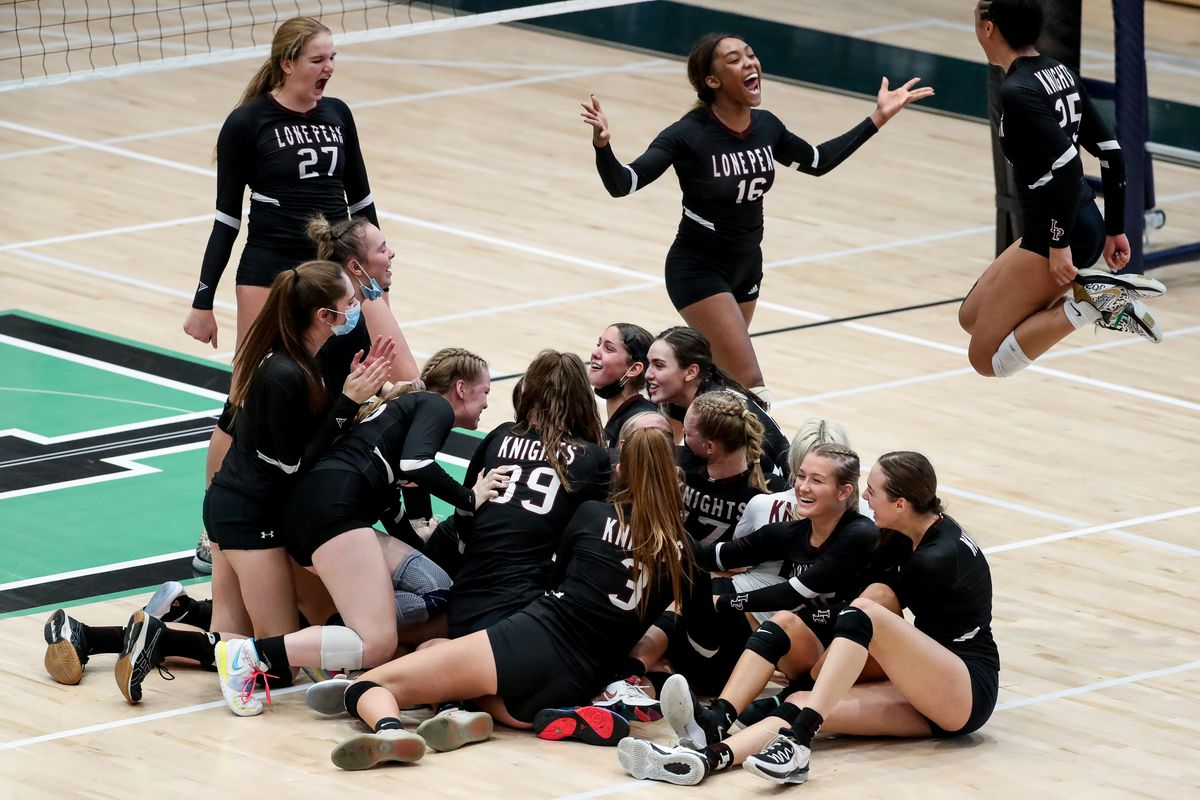 Lone Peak celebrates its win over Copper Hills in the 6A volleyball championship match at Hillcrest High School in Midvale on Saturday, Nov. 7, 2020.