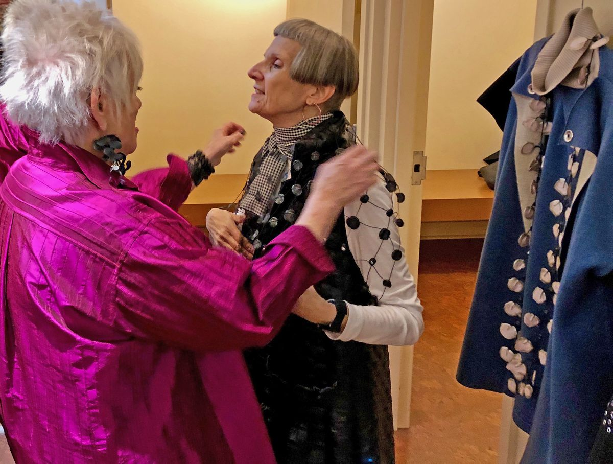 My Sister's Circus owner Sue Gantz (left) helps customer Elyse Koren-Camarra try on a quilted vest. Gantz says such personal service helped her store stay in business for half a century. There is also a branch in Highland Park.   Neil Steinberg/Sun-Times
