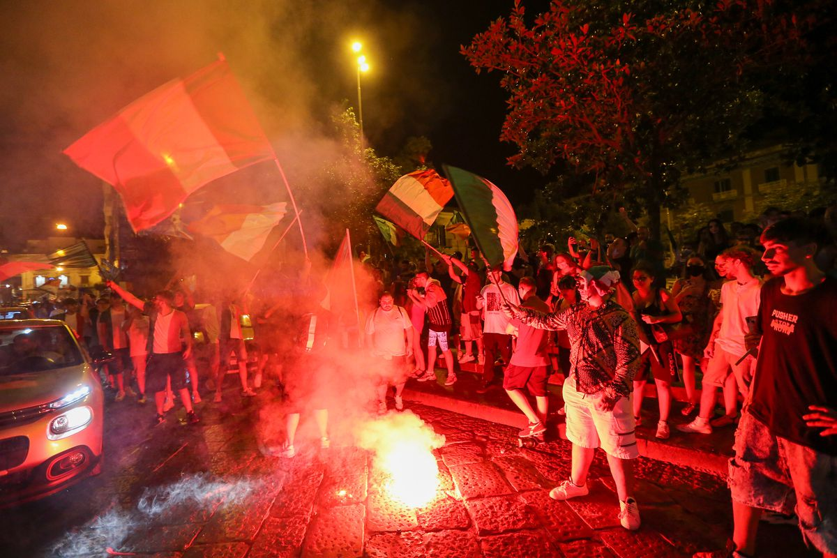 Fans of the Italian national football team celebrate victory...
