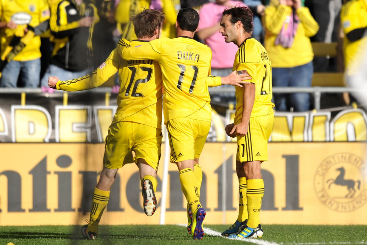 Fans are hoping Eddie Gaven, Dilly Duka, and Sebastian Miranda celebrate many more goals in 2012. (Photo by Jamie Sabau/Getty Images)