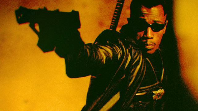 Actor Wesley Snipes raises a gun in a scene from the film Blade